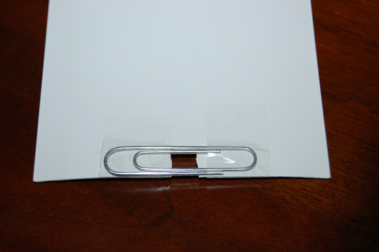 Tape the Paper Clip to Broken Vertical Blind